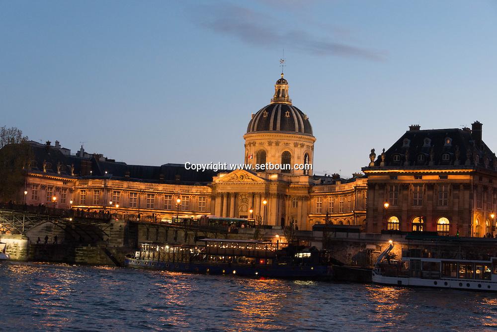 France. Paris. the french academy and Art bridge on the Seine river  / l academie francaise  le pont des arts sur la Seine