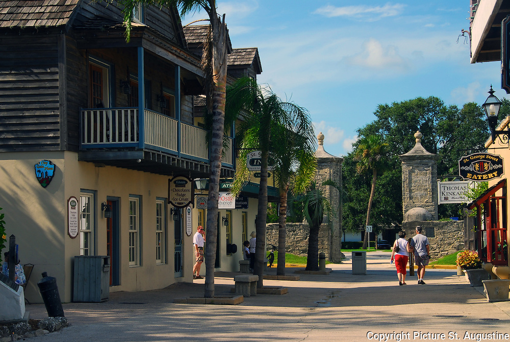 Visitors take a late afternoon stroll down St. George Street walking toward the City Gates in St. Augustine, Florida. St. George Street was the main thoroughfare through the colonial city and is still considered the heart of St. Augustine. Here you will find some of the historical attractions, restaurants, galleries and shopping that St. Augustine is known for. St. Augustine is the oldest continually occupied European city in the United States.
