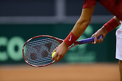 12-09-2014 NED: Davis Cup Nederland - Kroatie, Amsterdam<br /> Nike Tennis racket serve service, item Tennis
