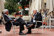 Alessandro Profumo, member of board of Eni, speaks with Giuseppe Garofano, Vice President of Alerion, at Ambrosetti Workshop in Cernobbio, September 2, 2011. © Carlo Cerchioli