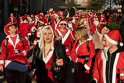 © Licensed to London News Pictures. 09/12/2017. London, UK. Participants dressed in Father Christmas costumes gather for the annual Santacon celebrations in Central London. Photo credit: Ray Tang/LNP