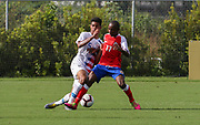 Team USA defender Antonia Leone (5) and Team Haiti forward Wilgene Dambreville (17) fight for possession of the ball during a CONCACAF boys under-15 championship soccer game, Sunday, Aug. 4, 2019, in Bradenton, Fla. The USA defeated Haiti 2-0 (Kim Hukari/Image of Sport)