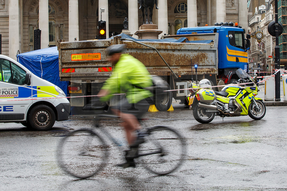 © Licensed to London News Pictures. 22/06/2015. London, UK. A cyclist goes past Bank junction in London where female cyclist died in a crash with a tipper truck during morning rush hour on Monday, June 22, 2015. Photo credit: Tolga Akmen/LNP