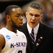 Kansas State head coach Frank Martin shouts instructions to Kansas State guard Jacob Pullen as Kansas State takes on Xavier as they play to decide who will advance to the elite eight of the NCAA Division 1 mens basketball Championship at a game at the EnergySolutions Arena in Salt Lake City, Utah Thursday, March 25, 2010.  August Miller, Deseret News .