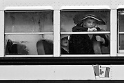Two Mennonite boys on a school bus in Hawkesville, Ontario on a chilly late October morning.
