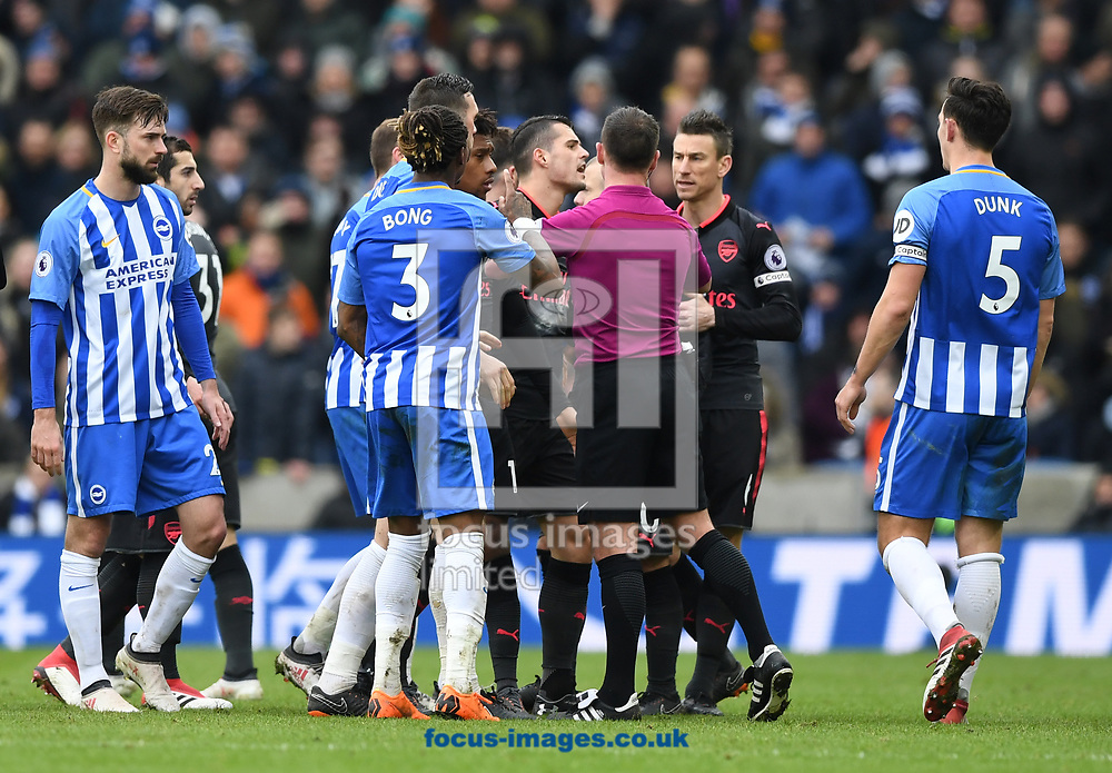 Referee Stuart Attwell tries to restore order during the Premier League match at the American Express Community Stadium, Brighton and Hove<br /> Picture by Simon Dael/Focus Images Ltd 07866 555979<br /> 04/03/2018