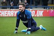 AFC Wimbledon goalkeeper Joe McDonnell (24) warming up during the EFL Sky Bet League 1 match between AFC Wimbledon and Southend United at the Cherry Red Records Stadium, Kingston, England on 1 January 2020.