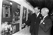 """05/04/1963<br /> 04/05/1963<br /> 05 April 1963<br /> Opening of """"Ulster Today"""" architectural photographic exhibition.Organised by the Royal Society of Ulster Architects opened at the Gallery of the Building Centre of Ireland  in Dublin in the presence of Donagh O'Malley, Parlimentary Secretary to the Minister for Finance and Sir Ian MacLennan, British Ambassador to Ireland. The exhibition was later displayed in Belfast. Picture shows: President of the Royal Society of Ulster Architects, Charles Munro ARIBA, (right) showing Donagh O'Malley (left) round the exhibition after the opening."""