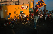Local 1990s kids on bikes watch an event on Venice Beach, on 18th May 1996, in Los Angeles, California, USA.