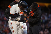 San Francisco Giants third baseman Eduardo Nunez (10) hits the ground after being hit in the arm by a Pittsburgh Pirates wild pitch at AT&T Park in San Francisco, California, on July 25, 2017. (Stan Olszewski/Special to S.F. Examiner)