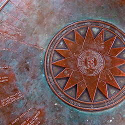 A braass compass rose and map in the fire tower at the John Wingate Weeks State Historic Site.  Lancaster, New Hampshire.