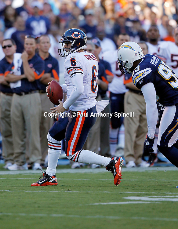 Chicago Bears quarterback Jay Cutler (6) rolls away from defensive pressure during a NFL week 1 preseason football game against the San Diego Chargers, Saturday, August 14, 2010 in San Diego, California. The Chargers won the game 25-10. (©Paul Anthony Spinelli)