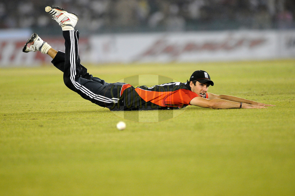 Steve Finn tries to stop a ball during the 3rd One Day International ( ODI ) match between India and England held at  the PCA Stadium, Mohali on the 20th October 2011..Photo by Pal Pillai/BCCI/SPORTZPICS