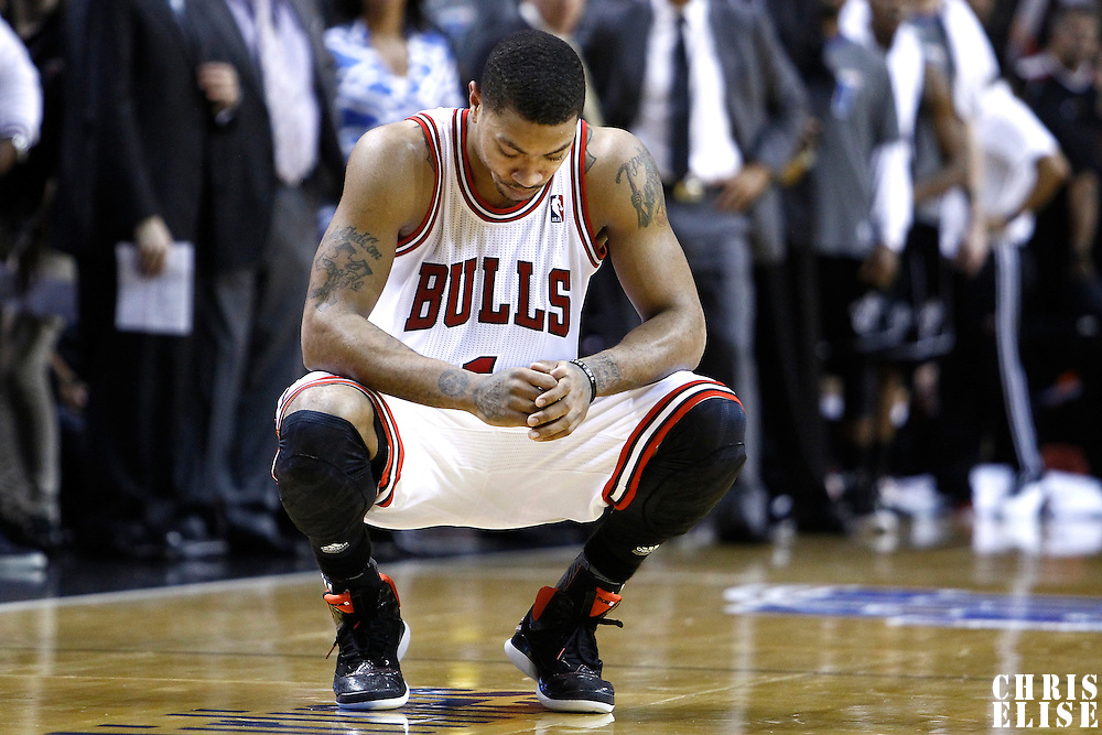 29 January 2012: Chicago Bulls point guard Derrick Rose (1) looks dejected at the end of the 4th quarter during the Miami Heat 97-93 victory over the Chicago Bulls at the AmericanAirlines Arena, Miami, Florida, USA.
