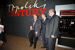 Left to right, BORIS JOHNSON, DAN TOPOLSKI and LORD RAZZALL at a party to celebrate the opening of Topolski Century held at The Arches, Hungerford Bridge, London SE1 on 16th March 2009.