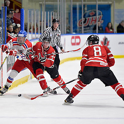 WHITBY, - Dec 16, 2015 -  Game #8 - Czech Republic vs. Canada East at the 2015 World Junior A Challenge at the Iroquois Park Recreation Complex, ON.  Grant Cooper #10 of Team Canada East takes a Czech player into to boards during the first period.<br /> (Photo: Shawn Muir / OJHL Images)