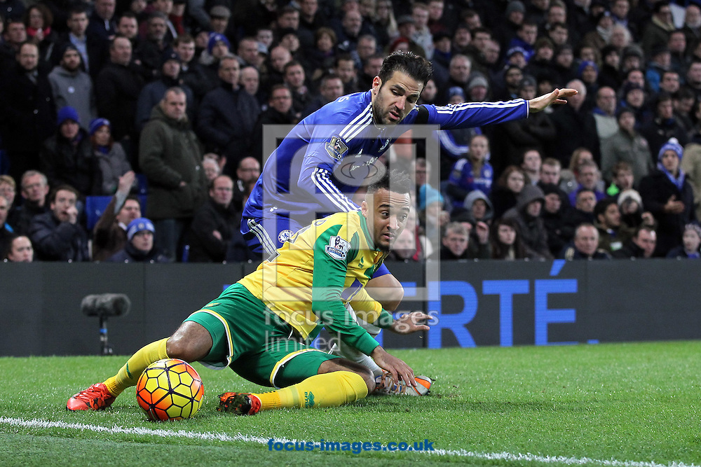 Nathan Redmond of Norwich and Cesc F&agrave;bregas of Chelsea in action during the Barclays Premier League match at Stamford Bridge, London<br /> Picture by Paul Chesterton/Focus Images Ltd +44 7904 640267<br /> 21/11/2015