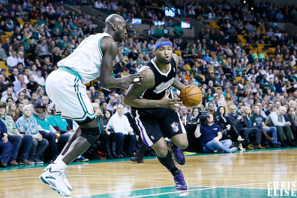 30 January 2013: Sacramento Kings center DeMarcus Cousins (15) drives past Boston Celtics power forward Kevin Garnett (5) during the Boston Celtics 99-81 victory over the Sacramento Kings at the TD Garden, Boston, Massachusetts, USA.