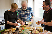 Members of the hiking group making a pack lunch for their walk at the Forget-me-Not centre, Swindon.