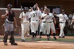 The Oregon State Beavers baseball team congratulate 1B Jordan Lennerton (37) after scoring a run against Rutgers.  The Oregon State Beavers defeated the Rutgers Scarlet Knights 5-2 in Game 5 of the NCAA World Series Charlottesville Regional held at Davenport Field in Charlottesville, VA on June 4, 2007.