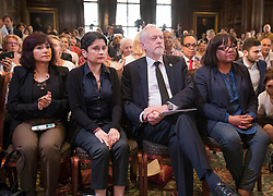 © Licensed to London News Pictures. 26/05/2017. London, UK. Labour party leader Jeremy Corbyn waits to re-start his election campaign with a speech in Westminster seated with (L-R) his wife Laura Alvarez and Labour Party shadow cabinet members Shami Chakrabarti and Diane Abbott . All election campaigning was stopped as a mark of respect for the victims of Monday's terror attack in Manchester in which 22 people died. Photo credit: Peter Macdiarmid/LNP