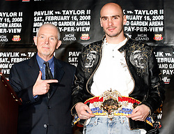 December 11, 2007; New York, NY, USA;  Unbeaten World Middleweight Champion Kelly Pavlik (r) receives his Ring Magazine Championship belt from Editor Nigel Collins (l) at the press conference announcing his rematch against former champion Jermain Taylor, which will take place Saturday, February 16, 2008, at MGM Grand in Las Vegas, NV.  Taylor missed attending the press conference due to the birth of his baby girl on Monday evening.