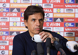 CARDIFF, WALES - Thursday, March 16, 2017: Wales' manager Chris Coleman drinks a cup of coffee during a press conference at the Vale Resort to announce his squad for the forthcoming 2018 FIFA World Cup Qualifying Group D match against Republic of Ireland. (Pic by David Rawcliffe/Propaganda)