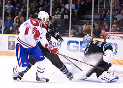 March 4, 2010; San Jose, CA, USA; San Jose Sharks goalie Evgeni Nabokov (20) saves a shot from Montreal Canadiens left wing Benoit Pouliot (57) during the first period at HP Pavilion.  San Jose defeated Montreal 3-2. Mandatory Credit: Jason O. Watson / US PRESSWIRE