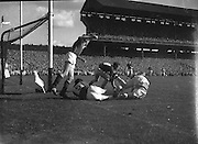 Group of players tackle for the ball during the All Ireland Senior Gaelic Football Final Down v. Offaly in Croke Park on the 24th September 1961.