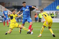 Ryan Tafazolli of Peterborough United is tackled by Agon Mehmeti of Oxford United - Mandatory by-line: Joe Dent/JMP - 30/09/2017 - FOOTBALL - ABAX Stadium - Peterborough, England - Peterborough United v Oxford United - Sky Bet League One