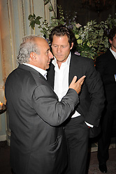 Left to right, SIR PHILLIP GREEN and ARKI BUSSON at a dinner hosted by Vogue in honour of photographer David Bailey at Claridge's, Brook Street, London on 11th May 2010.