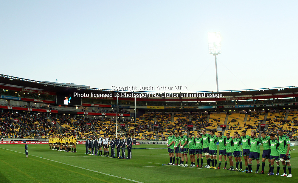 Teams stand for a minute silence during the 2012 Super Rugby season, Hurricanes v Highlanders at Westpac Stadium, Wellington, New Zealand on Saturday 17 March 2012. Photo: Justin Arthur / Photosport.co.nz