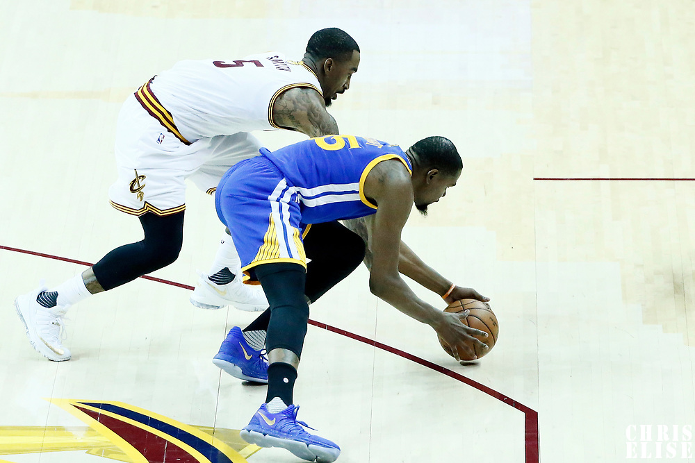 07 June 2017: Golden State Warriors forward Kevin Durant (35) vies for the ball with Cleveland Cavaliers guard JR Smith (5) during the Golden State Warriors 118-113 victory over the Cleveland Cavaliers, in game 3 of the 2017 NBA Finals, at  the Quicken Loans Arena, Cleveland, Ohio, USA.
