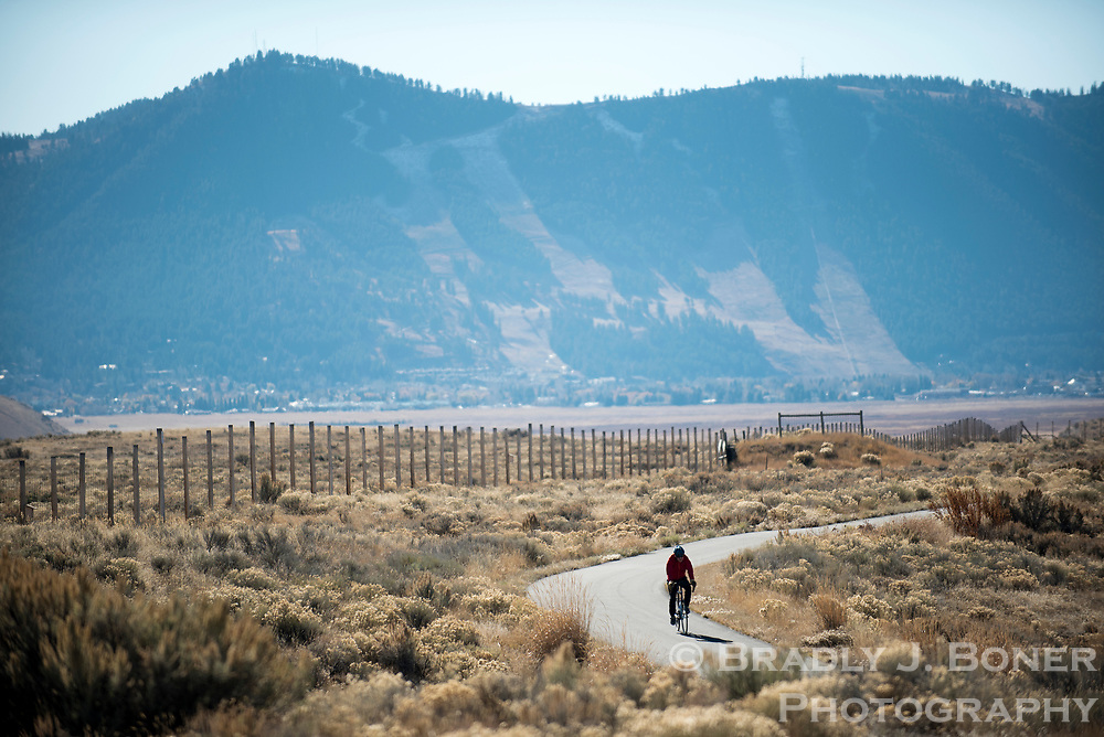 A cyclist cruises along the pathway between Highway 89 and the National Elk Refuge on Sunday afternoon. Users are reminded five-mile segment of the pathway between Flat Creek and the Gros Ventre River will close at the end of the day Tuesday to reduce impacts on migrating wildlife that winters on the refuge.