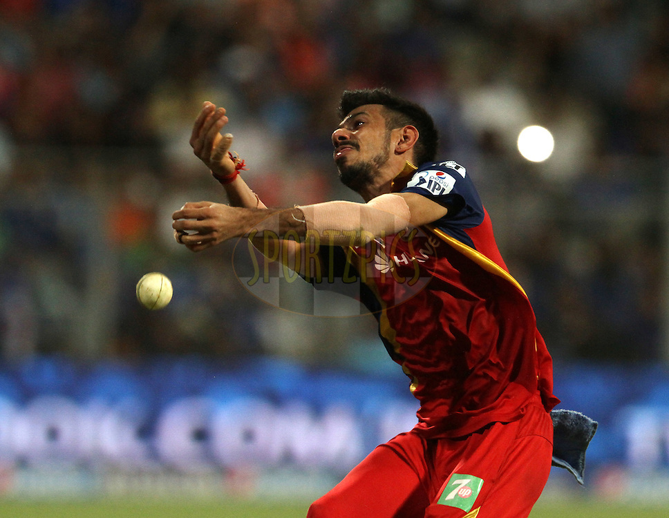 Royal Challengers Bangalore player Yuzvendra Chahal drops the catch of Mumbai Indians player Harbhajan Singh during match 46 of the Pepsi IPL 2015 (Indian Premier League) between The Mumbai Indians and The Royal Challengers Bangalore held at the Wankhede Stadium in Mumbai, India on the 10th May 2015.<br /> <br /> Photo by:  Vipin Pawar / SPORTZPICS / IPL