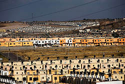 Residential areas sit near several industrial parks in the north of  Aguascalientes, Mexico on Monday , March 17, 2009.