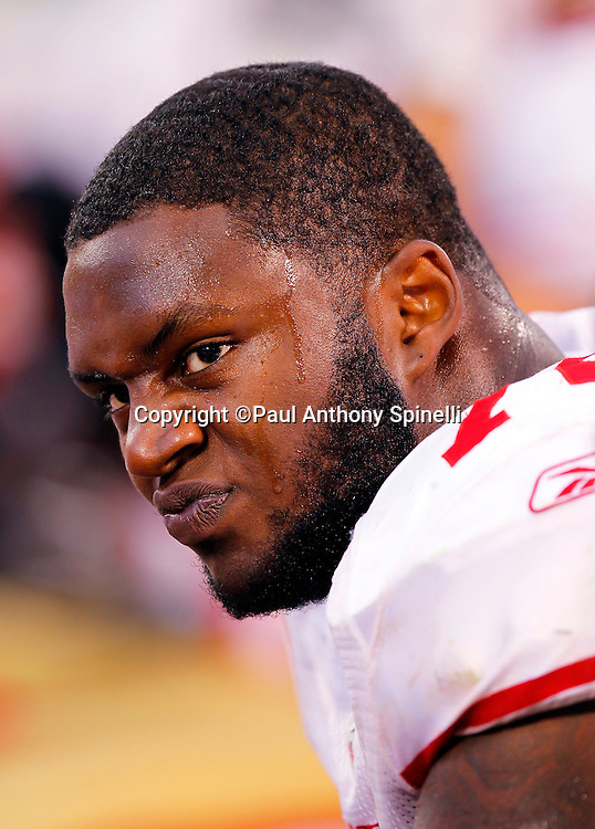 San Francisco 49ers offensive tackle Anthony Davis (76) looks on during a bench break during the NFL preseason week 3 football game against the Oakland Raiders on Saturday, August 28, 2010 in Oakland, California. The 49ers won the game 28-24. (©Paul Anthony Spinelli)