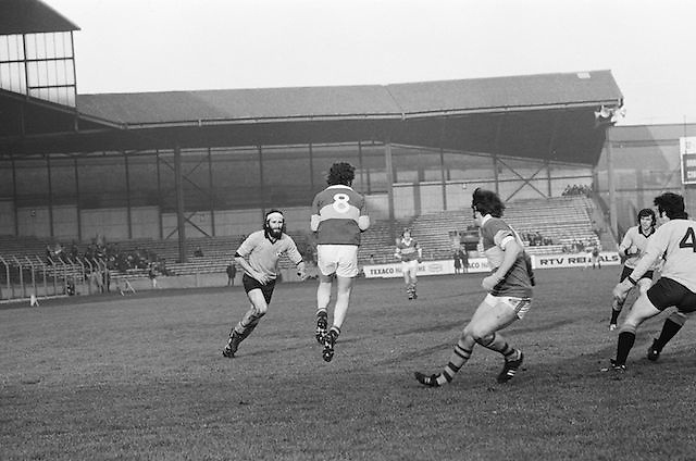 Kerry falls back to the ground after gaining possession of the ball during the All Ireland Senior Gaelic Football Semi Final, Dublin v Kerry in Croke Park on the 23rd of January 1977. Dublin 3-12 Kerry 1-13.