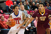 DALLAS, TX - DECEMBER 29: Nic Moore #11 of the SMU Mustangs drives to the basket against the Midwestern State Mustangs on December 29, 2014 at Moody Coliseum in Dallas, Texas.  (Photo by Cooper Neill/Getty Images) *** Local Caption *** Nic Moore