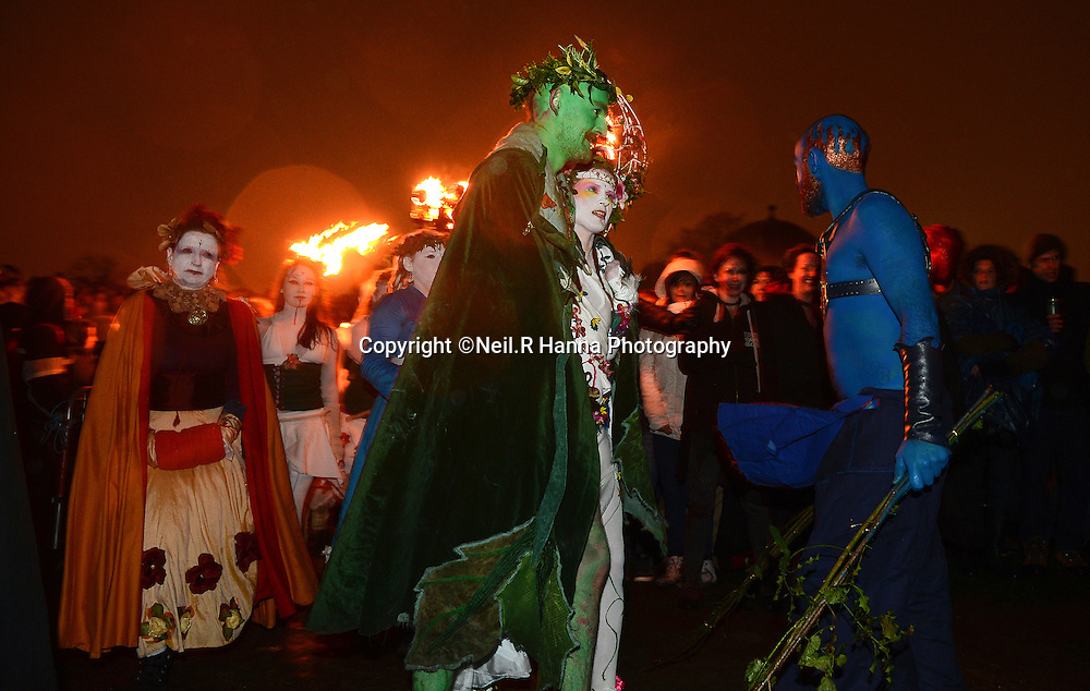 Beltane Fire Festival 2014 Picture Shows: After the stage performance signifying the inception of summer the May Queen and Green Man spark the birth of summer by lighting a huge bonfire.<br /> <br /> The festival takes place on Calton Hill. It is a procession, which starts at the National Monument and proceeds anti-clockwise around the path meeting various groups along the way. The procession is driven by the beat of drums which urge it inexorably towards summer. At the procession's head is the May Queen and the Green Man, followed by a cavalcade of characters who are intrinsically linked to them and their journey.<br /> <br /> Their destination is punctuated by various groups who either help or hinder their progress towards the Green Man's fate and the May Queen's destiny.<br /> <br /> After a dramatic stage performance signifying the inception of summer the May Queen and Green Man spark the birth of summer by lighting a huge bonfire. The performance then moves into its community phase. All the participants congregate in a place called the Bower. From here the finishing movements of the festival are played out in a dance of reds and whites. <br /> <br /> Pictures by  Neil Hanna  - mobile 07702246823