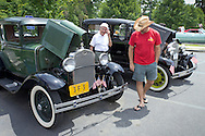 Middletown, New York - People look at cars on display at the YMCA Community Fun Day Car Show at the Middletown YMCA on June 2, 2013. The YMCA of Middletown hosted the show in partnership with the Tri-States Car Club and Elks Lodge 1097. ©Tom Bushey / The Image Works