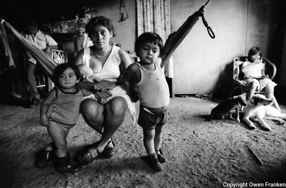 Nicaragua, family-mother in hammock with three children