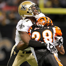 2009 August 14: New Orleans Saints safety Pierson Prioleau (31) tackles Cincinnati Bengals running back Bernard Scott (28) during a preseason opener between the Cincinnati Bengals and the New Orleans Saints at the Louisiana Superdome in New Orleans, Louisiana.