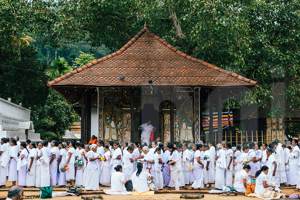 Crowds gather outside the Temple of the Tooth for free breakfast on Poya Day, Kandy, Sri Lanka, Asia