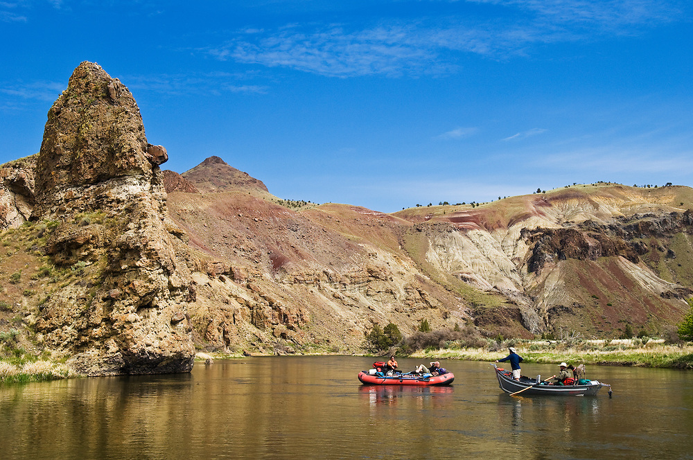 Rafters and driftboaters in glassy water on the John Day River, Oregon.