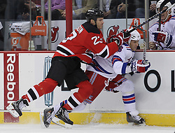Nov 5, 2010; Newark, NJ, USA;  New Jersey Devils center David Clarkson (23) hits New York Rangers left wing Sean Avery (16) during the first period at the Prudential Center.