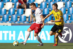 June 16, 2019 - Reggio, Italy - Poland's Szymon Zurkowski and Belgium's Bryan Heynen fight for the ball during a game between the U21 youth team of the Belgian national soccer team Red Devils and Poland, Sunday 16 June 2019, match 1/3 in group A at the 2019 European championships under 21 in Reggio, Italy. (Credit Image: © Bruno Fahy/Belga via ZUMA Press)