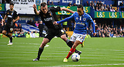 Lee Collins leans in for the challenge on Kyle Bennett;  during the Sky Bet League 2 match between Portsmouth and Mansfield Town at Fratton Park, Portsmouth, England on 24 October 2015. Photo by Michael Hulf.