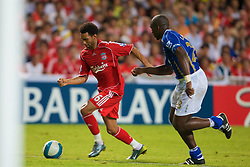 Hong Kong, China - Friday, July 27, 2007: Liverpool's Jermaine Pennant and Portsmouth's Sol Campbell during the final of the Barclays Asia Trophy at the Hong Kong Stadium. (Photo by David Rawcliffe/Propaganda)
