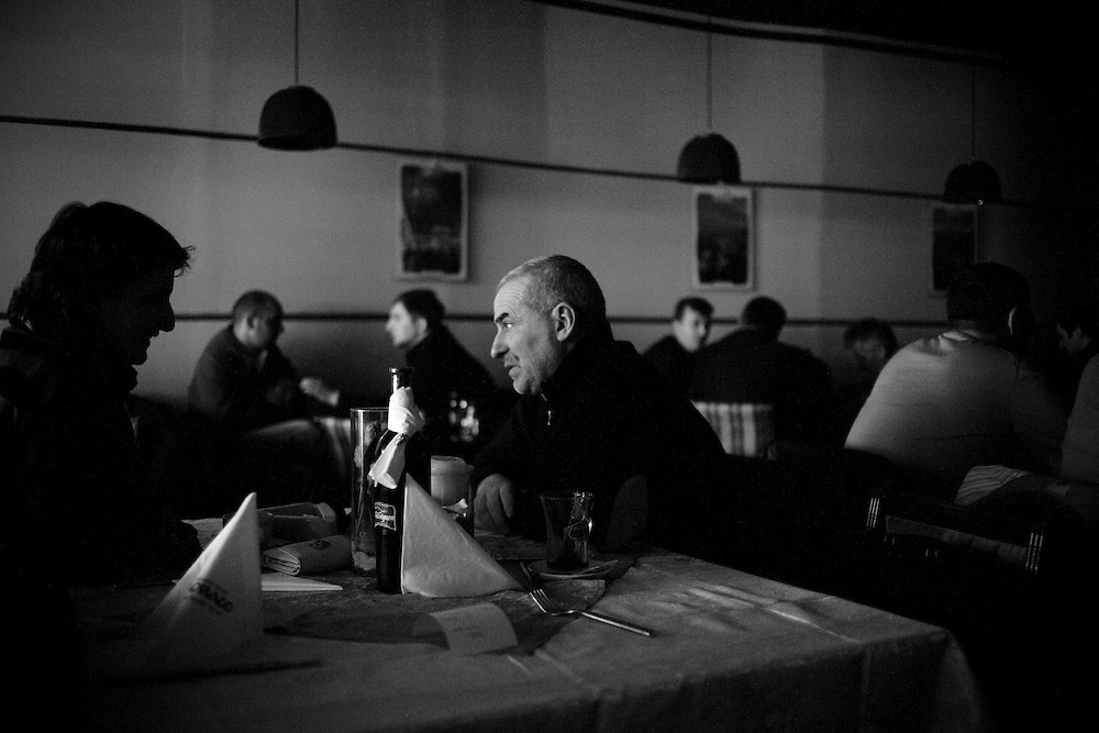 A power cut in a restaurant in central Pristina, Kosovo, on Nov. 29 2007. Power cuts are a regular occurrence in Kosovo, working through the city sector by sector, but they don't stop people getting on with their everyday lives.